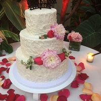 Rustic Garden Wedding Cake Rustic buttercream with fresh flowers.