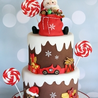Santa Cake Santa, bag, toys, and candy modeled with colored Fondx. Cake covered in homemade brown, then white, LMF fondant. I used Rhu's free...
