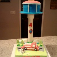 Paw Patrol Marshall Buttercream And Fondant Birthday Cake Paw Patrol tower is fondant, bottom layer is buttercream with fondant decorations. Firetruck and Periscope is made with Rice Krispie Treats...