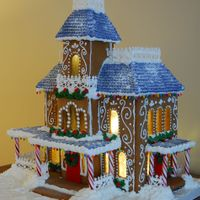 Lighted Victorian Gingerbread House Gingerbread house decorated with royal icing.