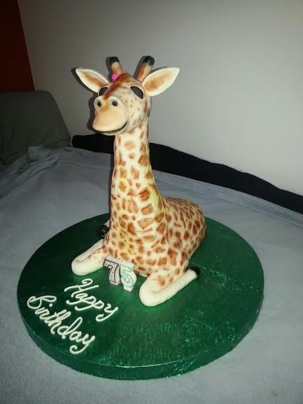 Giraffe Vanilla cake with buttercream and fondant. Then I airbrushed it.