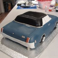 "Oldsmobile 442 Cake Chocolate cake 12"" by 7"". Covered in fondant with all fondant details! I had pictures of my client's car. Fun to replicate..."