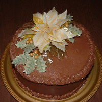 Ivory Poinsettia Chocolate cake with peanut butter filling. Fondant and gelatin poinsettia and leaves