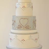 Forever Yours Wedding Cake I have found a new and exciting way to use jeweled ribbon. I have created several designs and this is one display of many more to come. I...