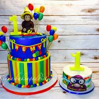 Curious George 1St Birthday Cake This First Birthday cake features Curious George made of modeling Chocolate. The balloons, bananas, number one cake toppers are all fondant...