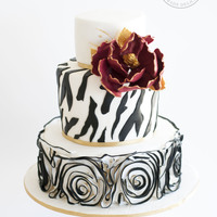 Bold Black & White A bold bat mitzvah cake with zebra stripes and black and white rosette ruffles.