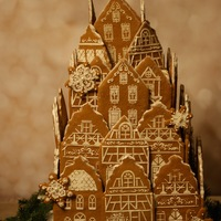 Christmas In Germany   A 3 tier cake which is covered with gingerbread house facades reminiscent of a small village in Germany.