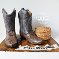 There's A Cake In My Boots! HOWDY PARTNER! There's a CAKE in my boots!Life sized cowboy boots cake made for a Wild wild West (East) party for Denis' 50th...
