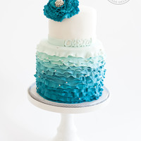 Blue Ombre Ruffled Bat Mitzvah Inside blue ombre velvet cake with layers of cream cheese frosting covered in white chocolate ganache.
