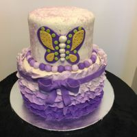 Butterfly And Ruffles I made this for a family member who just turned 9 years old. She loves butterflies, purple and sparkles. The cakes were strawberry with...