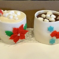 "Christmas Cake Individual ""hot cocoa"" cake cups. Complete with candy cane and marshmallows. All edible wrapped in white fondant..."