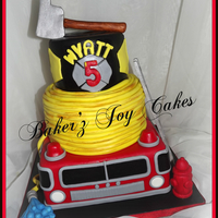 Firetruck Cake Firetruck cake in 2 different flavors. Marble bottom and middle tier and Mint Chocolate chip top tier. All edible. Handmade ladder, axe,...