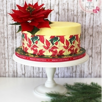 Our Christmas Cake <3 This was our christmas cake for this year. This was the first time I've made a poinsettia and I think it comes out good ;)