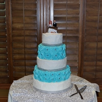 Buttercream Rosette Wedding Cake  All done is buttercream. there are rhinestones in some of the rosettes and rhinestone ribbon around the base. The white layers are done in...