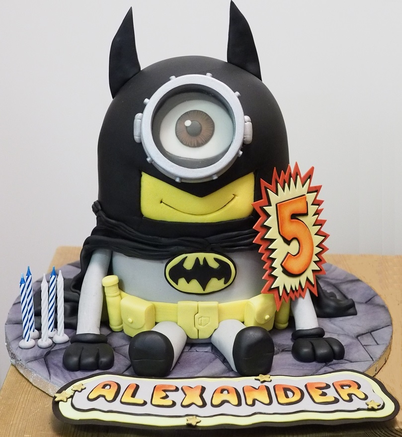 Batman Minion Cake My son's 5th birthday cake. Red velvet layer cake filled with white chocolate smbc (as requested by him), frosted with chocolate...
