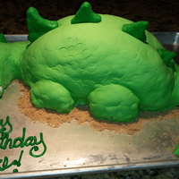 Dinosaur Birthday Cake! Marshmallow fondant over buttercream. Tail and head were MMF covered rice krispy treats