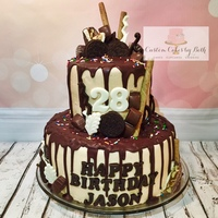Ganache Drip Birthday Cake Top tier is chocolate fudge brownie cake with cookies and cream filling. Bottom tier is banana cake with cream cheese filling. Iced in...