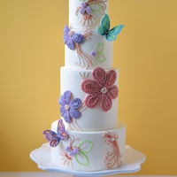 Summer Breeze For this cake, I combined traditional techniques with a modern design aesthetic incorporating hand piped, royal icing details with a modern...