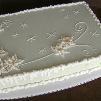 Mint Winter Sheet   eggnog-nutmeg cake, vanilla SMBC, vanilla ABC trim, piped snow/poinsettias, gold pearl dust gilding, 1/4 sheet