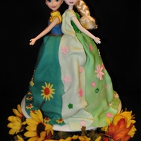 Frozen Fever Inspired Anna And Elsa Cake Frozen Fever inspired cake featuring Anna and Elsa.