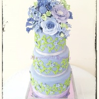 3 Tier Purple And Lime Green Wedding Cake   3 tier purple and green floral wedding cake