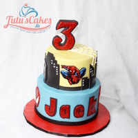 Spider Man/edible Image Both tiers are iced in buttercream. Edible image and fondant decorations.