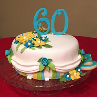 60Th Birthday Cake My sister's birthday is on Christmas Eve, but this year her cake didn't have a hint on holiday red & green.