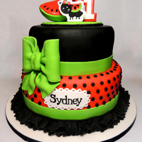 Watermelon Birthday Cake This cake was so much fun. The mom sent me pictures of her little girl's birthday out fit and I got to design a cake to match. All...