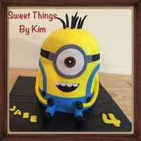 Minion   # 6 inch cake top is a Pyrex bowl.Yellow is all BC (Took forever to get so smooth)Decorations Fondant