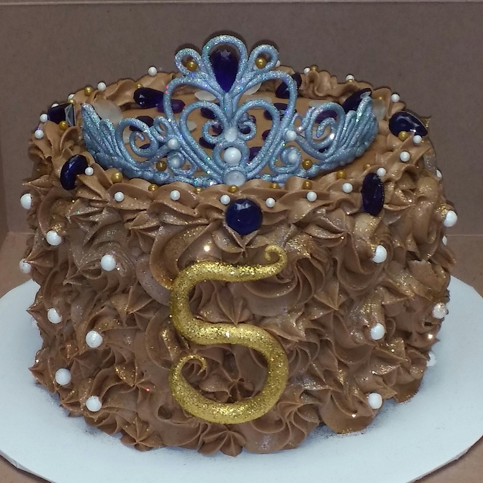Bling Cake Small chocolate buttercream cake loaded with bling for a young lady. Gumpaste crown with sugar pearls and Isomalt gems. Edible silver and...