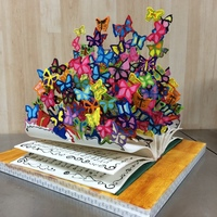 "Sugarcraft Version Of David Kracov's ""book Of Life"" Sculpture David Kracov's butterfly sculpture is so beautiful that I wanted to try a sugar version of it.It wasn't easy because I didn'..."