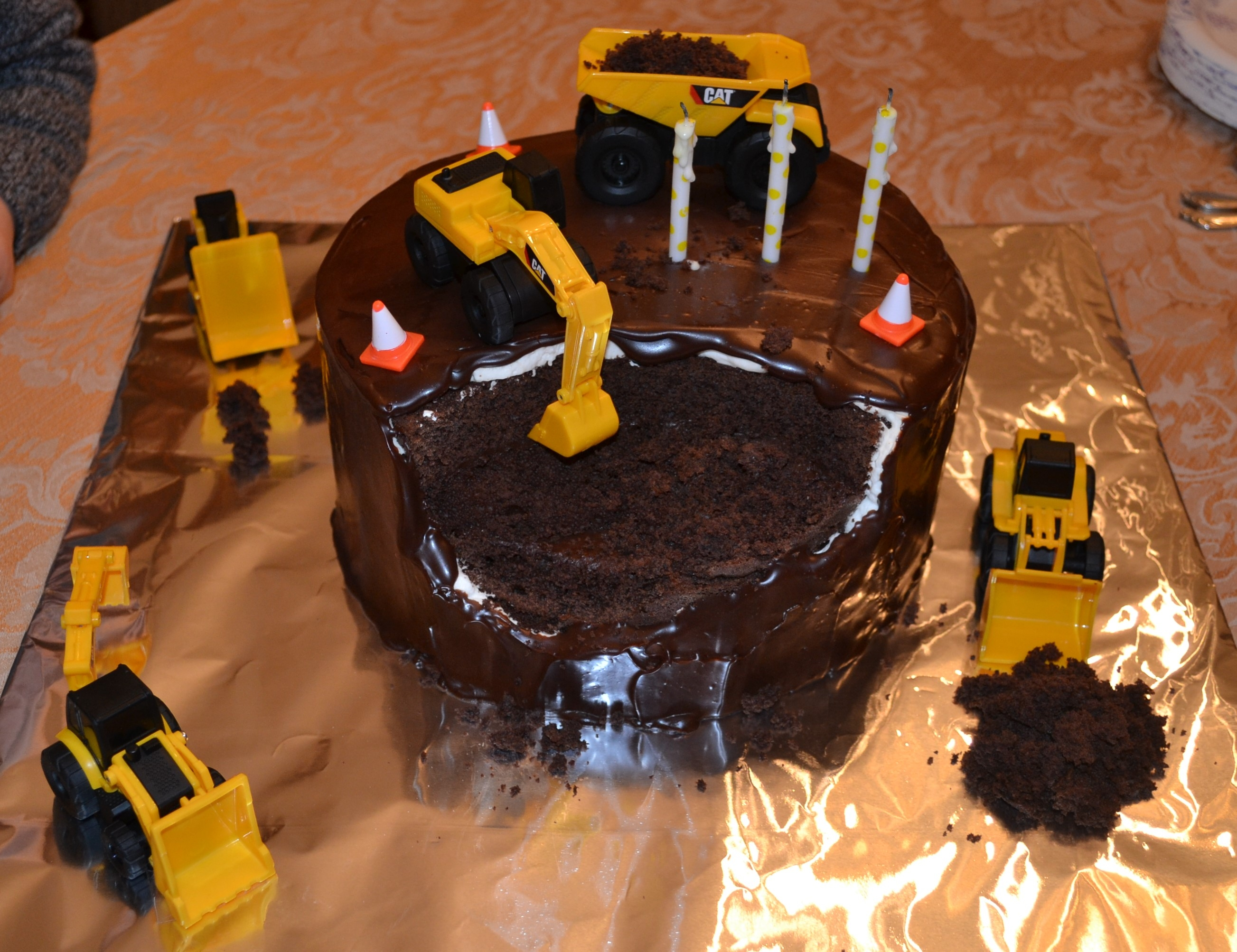 Construction Machinery Birthday Cake I made this cake for my son's 3rd birthday. Chocolate cake torted with chocolate ganashe, covered in whipped cream then covered again...