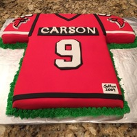 Football Jersey Vanilla cake covered in fondant for a 9 year old birthday boy,
