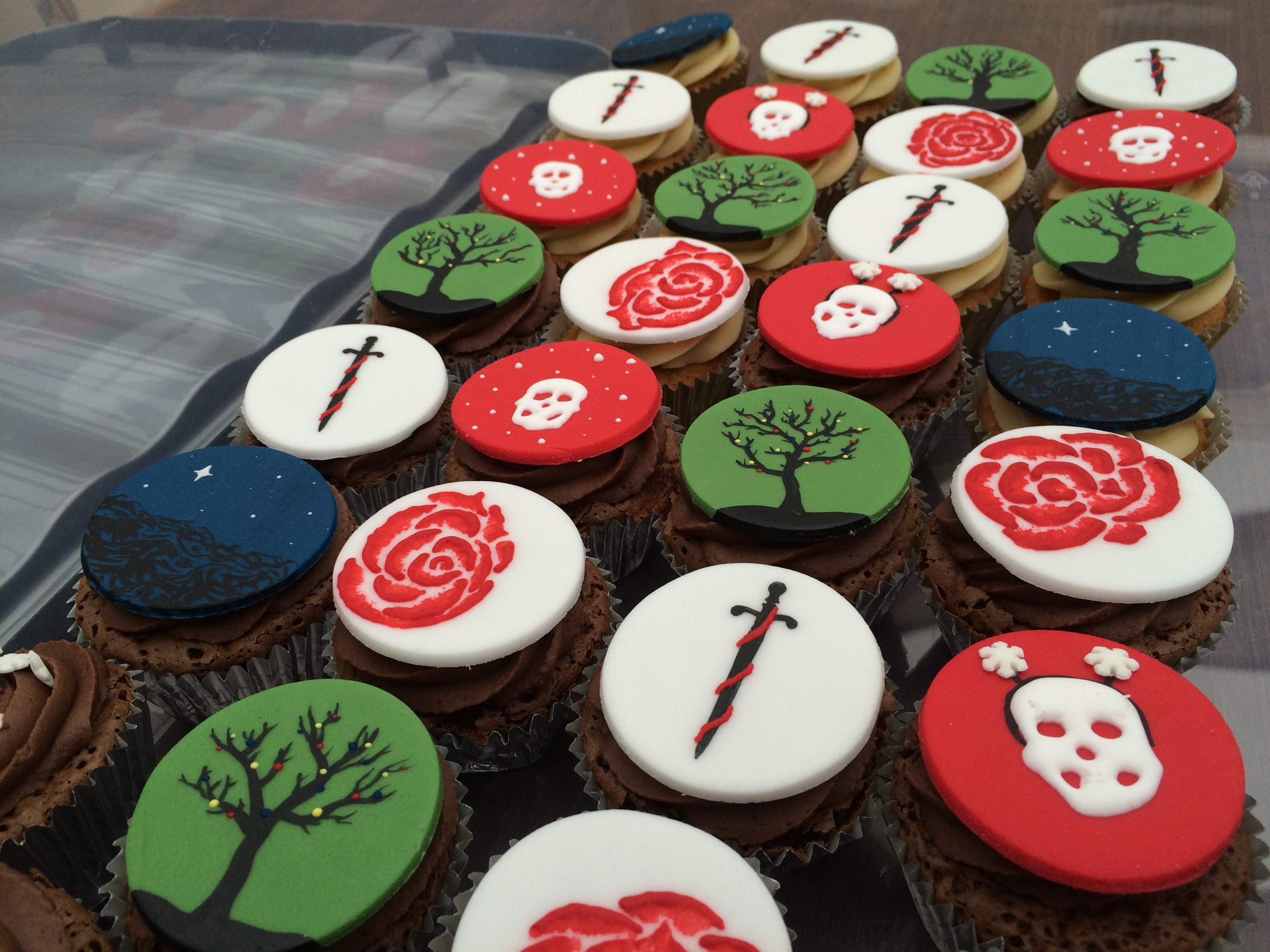 Festive Shakespeare Cupcakes Chocolate and gingerbread cupcakes decorated with hand-painted, festive, Shakespeare-themed toppers :). Tree = King Lear,Skull = Hamlet,...