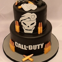 Call Of Duty Black Ops Cakes Call of Duty Black Ops theme cake. Hand cut skull face, lettering, dog tags. Molded bullets and gun. Grenade hand modeled from gumpaste....