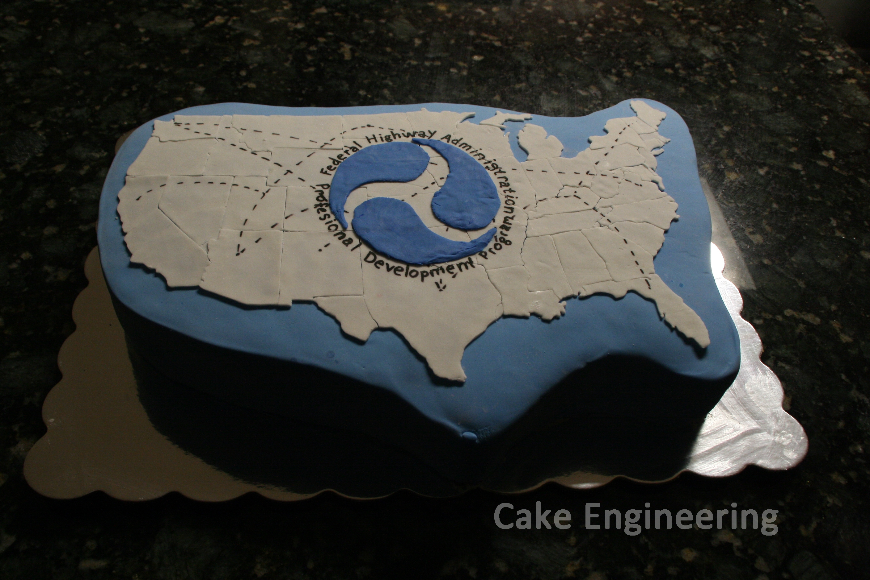 Fhwa - Professional Development Program Cake Half chocolate half vanilla cake with fondant decorations