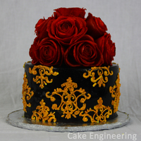 Gothic Wafer Paper Rose Cake Chocolate cake with strawberry filling decorated with fondant and royal icing decorations. Roses are made out of wafer paper.