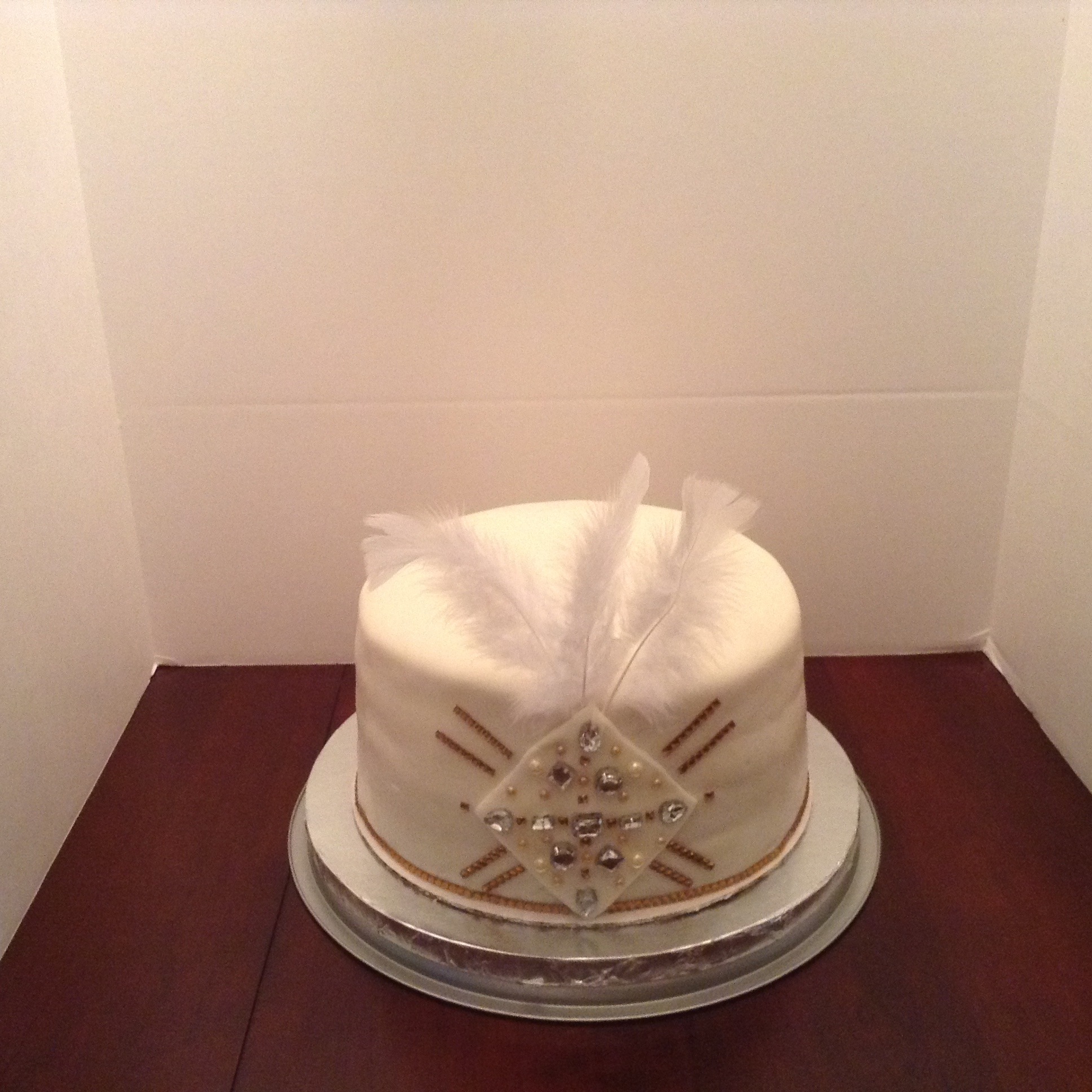 Great Gatsby Strawberry cake with marshmallow fondant,jewel accents and feathers