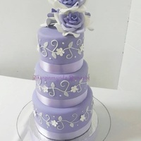 3 Tier Lilac Wedding Cake   3 tier lilac and white scroll wedding cake