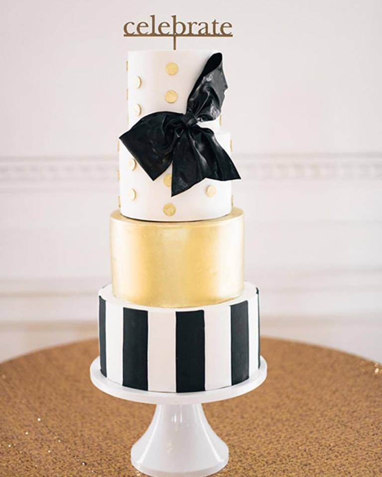 Kate Spade Wedding Cake   Modern touches of black and white stripes and gold with a Kate Spade signature bow.