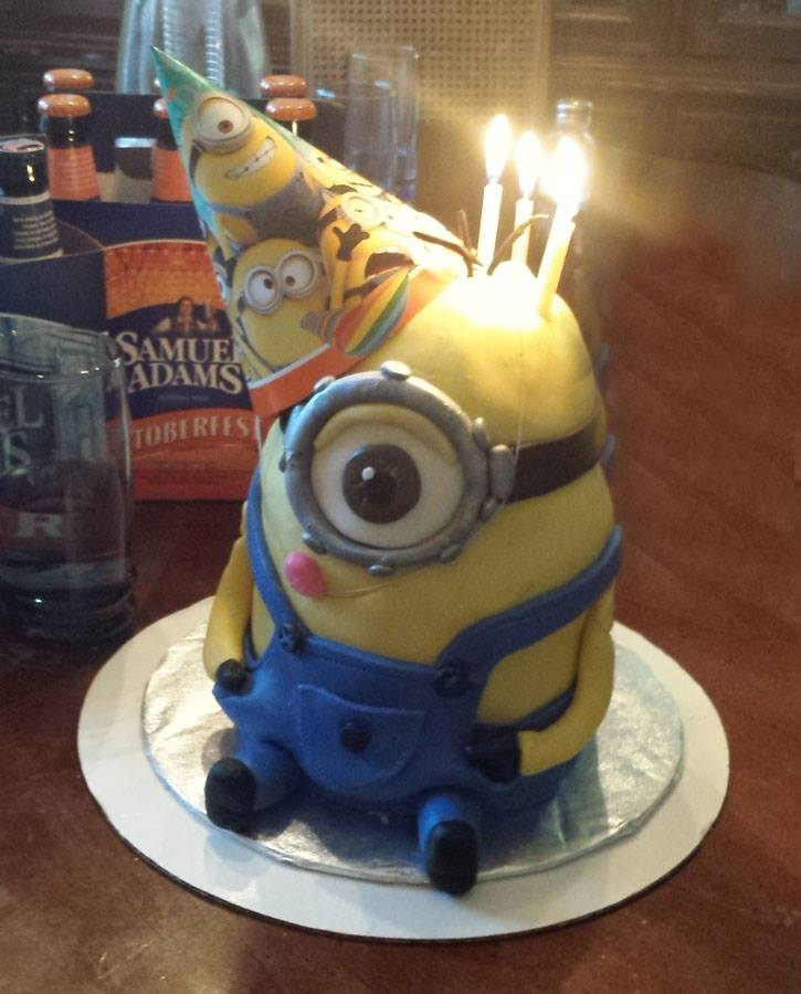 Minion Birthday   Minion birthday cake with carrot cake and cream cheese filling and crumb coat. Fondant covering.