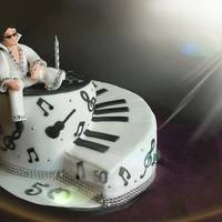 Elvis Piano Cake Elvis model sat on a piano twist cake