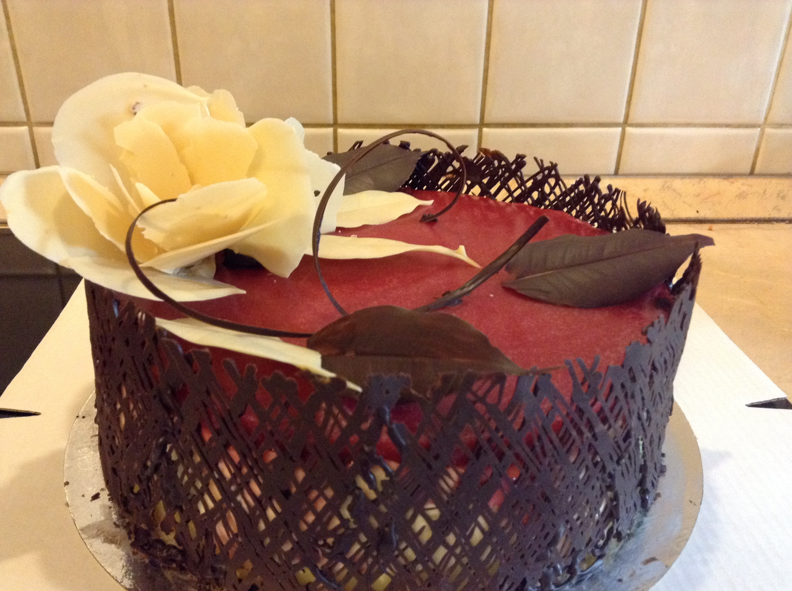 Not Baked Cheesecake With Chocolate Flowers And Leafs This is a burthday cake consisting of 4 layers:biscuit, lemon curd, not baked cheesecake and strawberry jelly. There are a couple of...