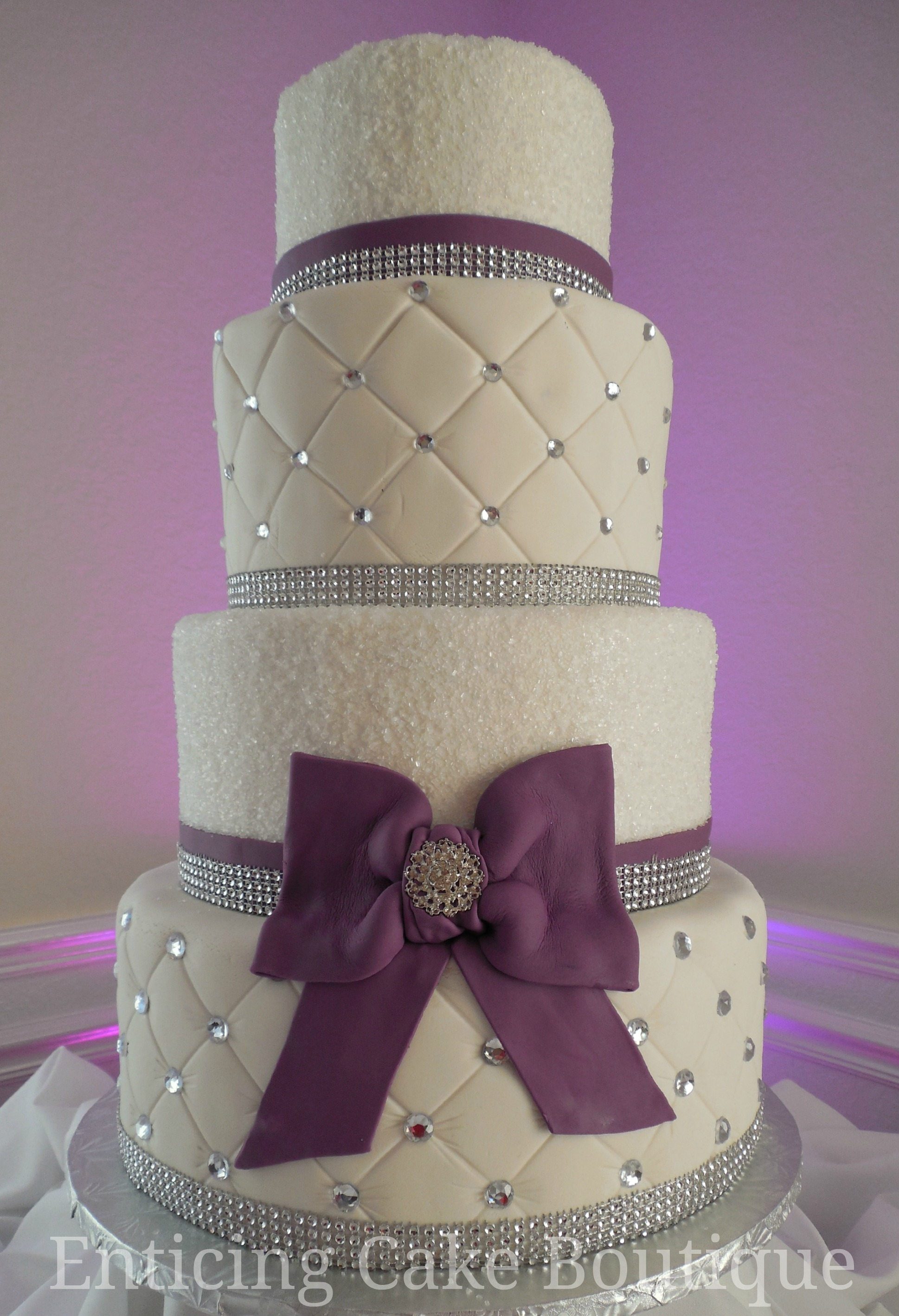Purple And White Crystal Wedding Cake White quilted fondant with purple accents and bling.
