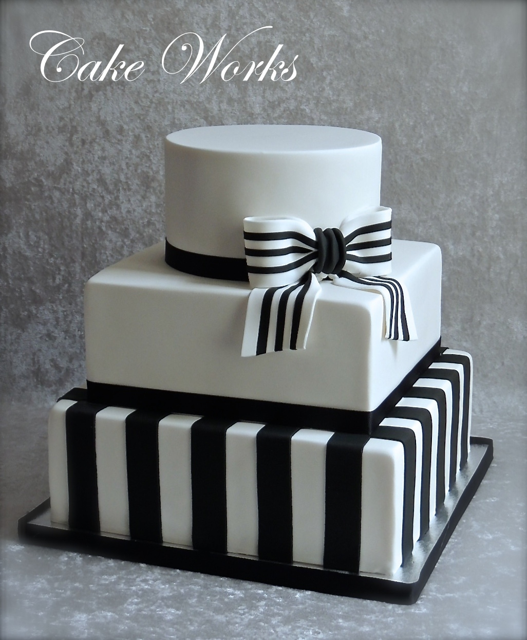 Simple Black And White Wedding Fondant covered cake with Black and white striped gum paste bow