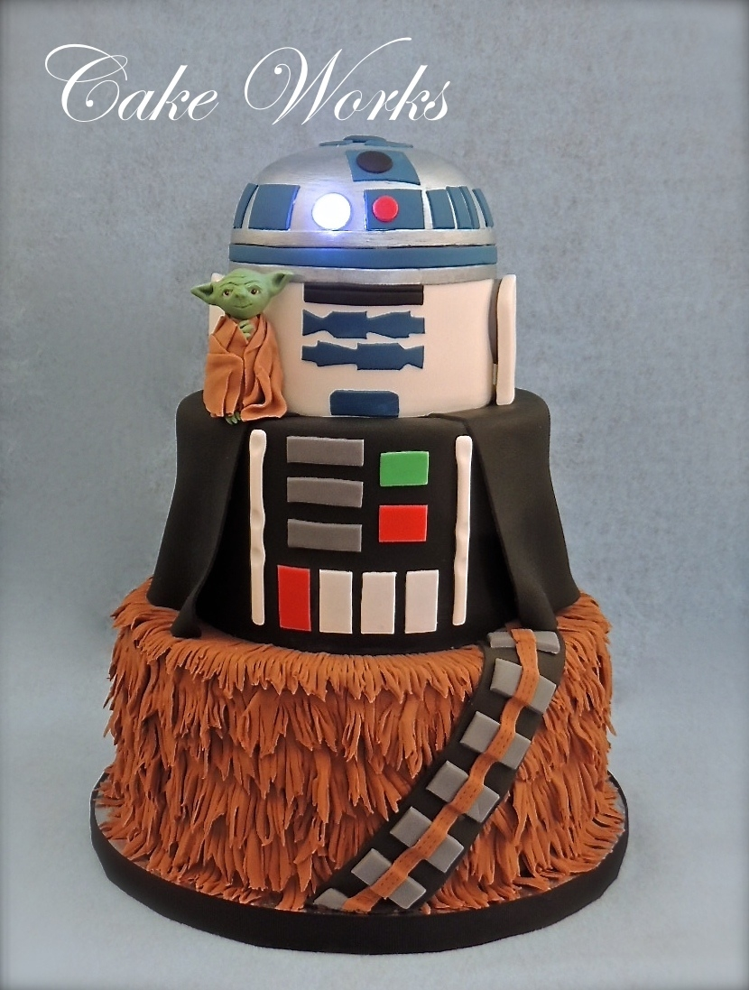 Star Wars Inspired Birthday Fondant covered. R2D2 tier has an led light eye. Gumpaste yoda.
