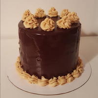 Peanut Butter Chocolate Cake This is a three layer chocolate cake filled and topped with peanut butter mousse with chocolate ganache poured over the top. While only 8...
