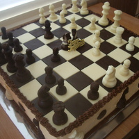 Chessboard Cake  Cake is 16 inch square.Covered with orange flavoured buttercream.Chess squares are chocolate, made in moulds.Chess pieces are also...