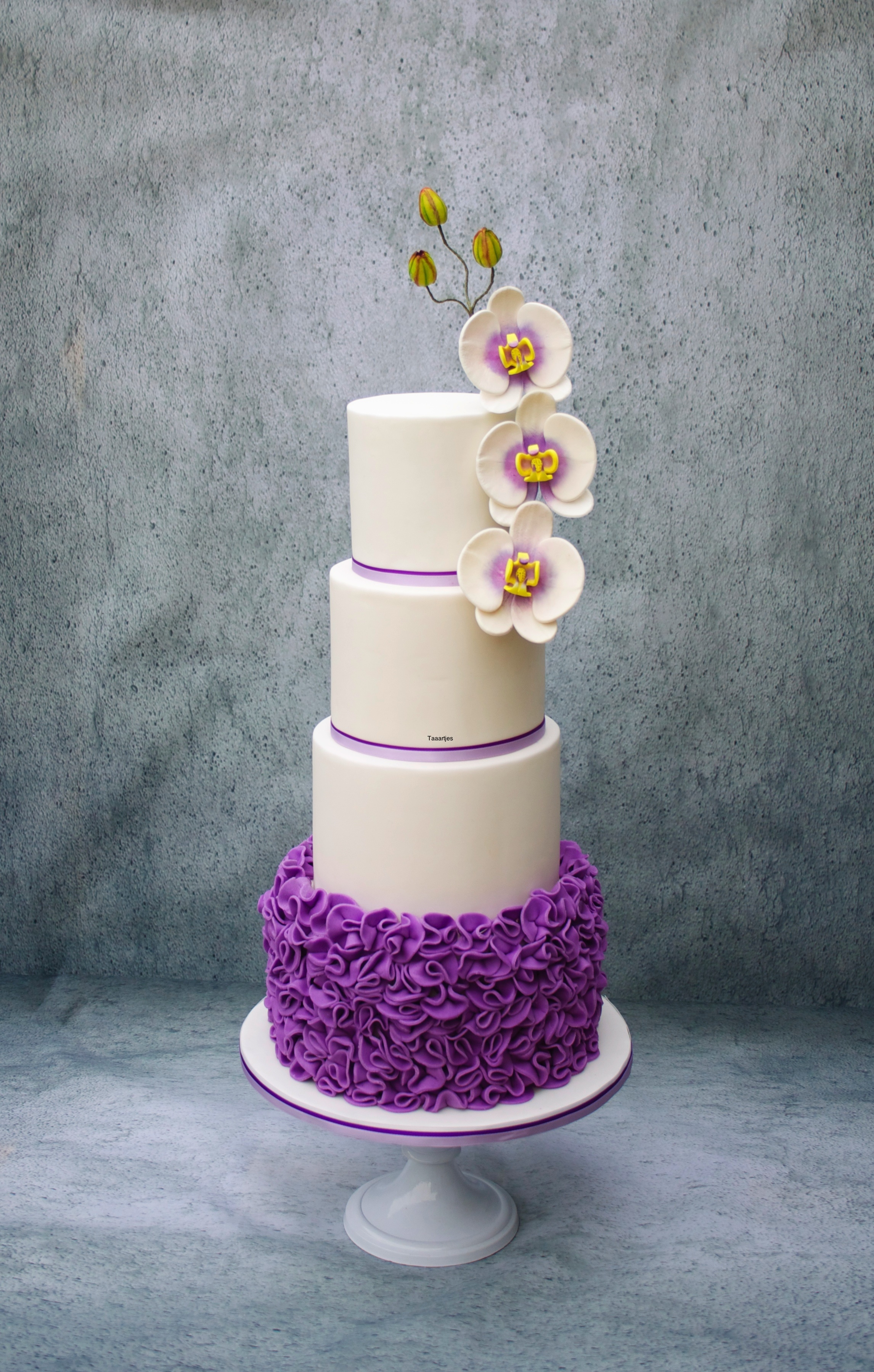 Wedding Cake With Ruffles And Handmade Orchids Wedding cake with ruffles and handmade orchids