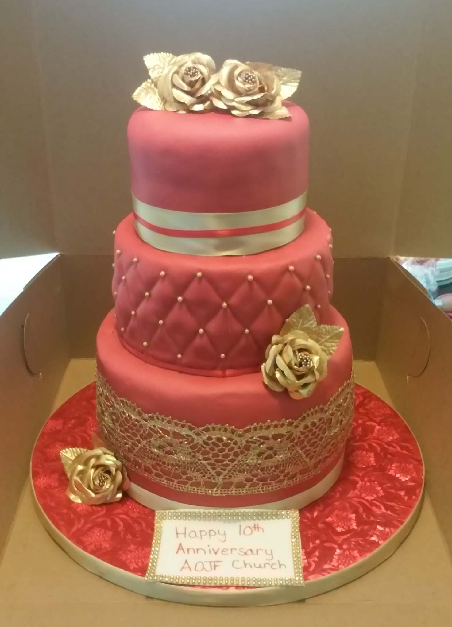 3 Tier Red And Gold Themed 10Th Anniversary Cake